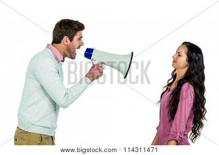 Screaming man holding loudspeaker with girlfriend on white background
