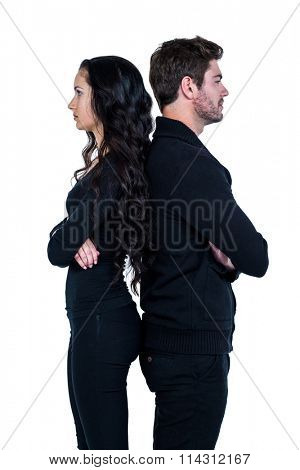 Couple standing back to back after argument on white background
