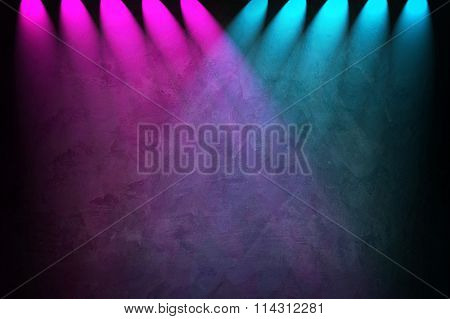 concrete wall with colorful spotlight