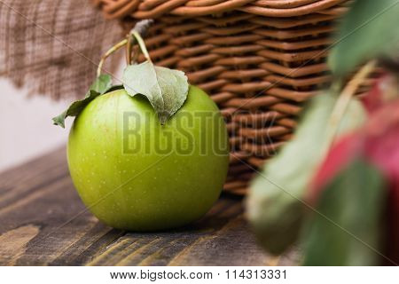 Green Apple Near Basket