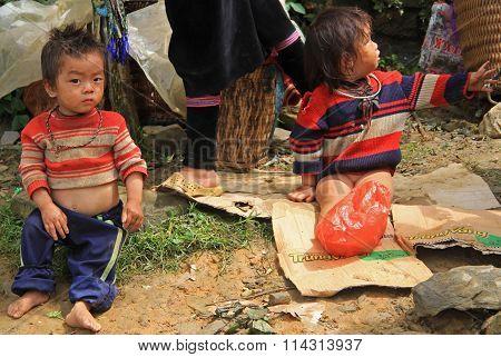 children are sitting outdoor in CatCat village, Vietnam