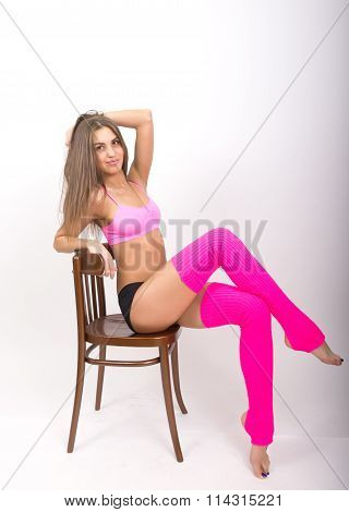 Sports slender girl is in shorts and sports socks