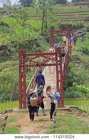 tourist group made stop at the foot bridge in Sa Pa, Vietnam