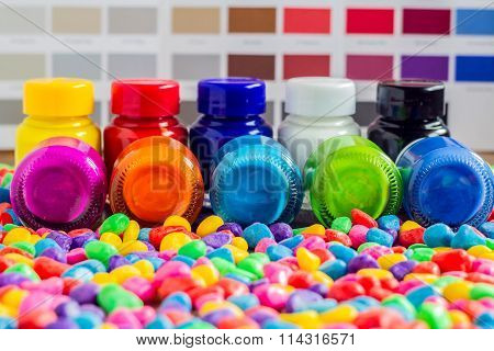 Bottles Color On Multicolored Small Stone  With Background Color Chart