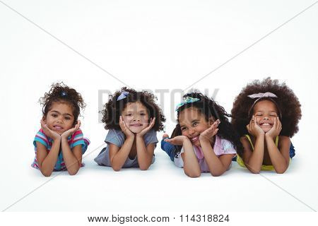 Cute girls laying on the floor with head on hands on white screen