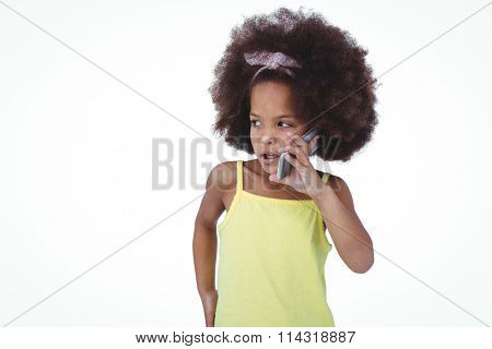 Cute girl standing on a phone call looking around on white screen