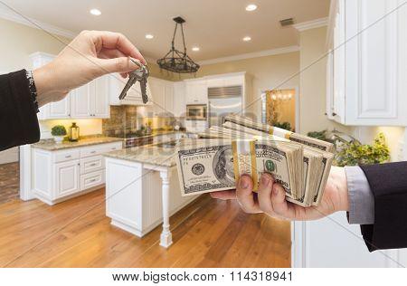Handing Over Keys for Cash In Beautiful Custom Kitchen Interior.