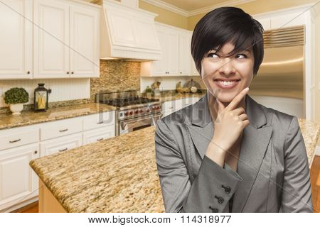 Pretty Mixed Race Woman Looking Back Over Shoulder Inside Custom Kitchen Interior.