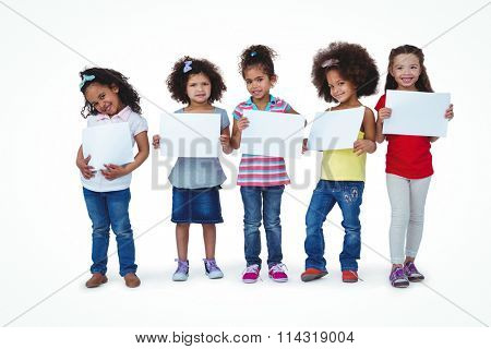 Cute girls showing sheets of paper on white screen