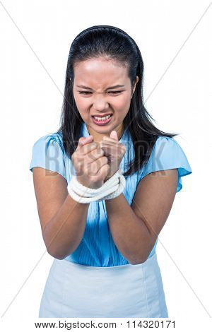 businesswoman being tied up on white background