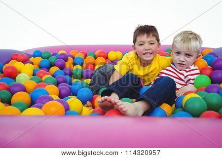 Cute smiling boys in sponge ball pool looking at camera