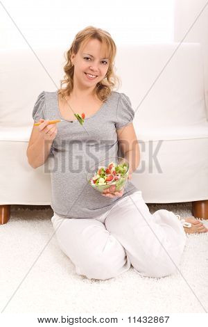 Beautiful Pregnant Woman Eating Salad