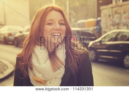 Portrait of young smiling red-haired (ginger) girl.