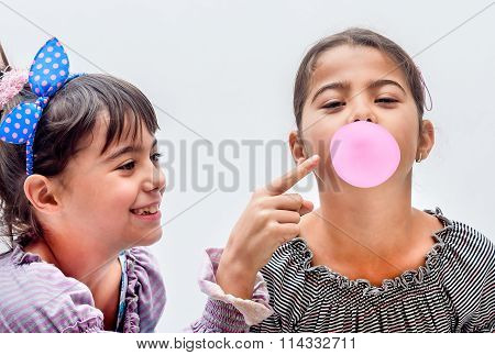Portraits Of Beautiful Little Girls Blowing Bubbles