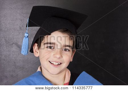 school-age child with the graduation robe, graduation