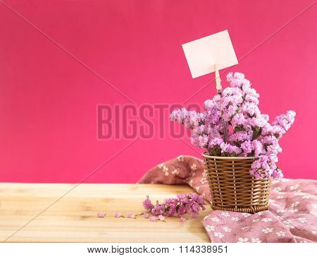 Sweet Statice Flower In Basket With Blank Paper Label On Red Pink Background And Wooden Table , Roma