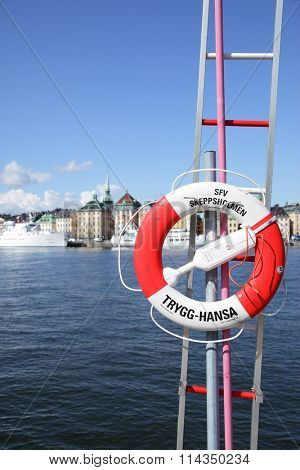 STOCKHOLM, SWEDEN - May 21, 2015: Recovery aids (lifebuoy and ladder) on waterfront in Stockholm