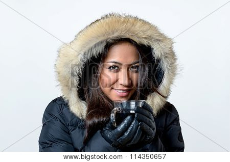 Smiling Young Woman Enjoying A Hot Beverage
