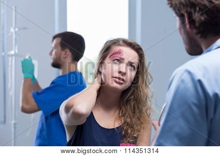 Injured Woman Talking With Surgeon