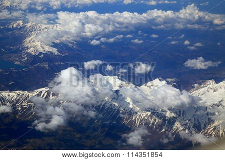 Aerial View Snow Mountain From Window Of Airplane
