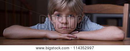 Boy In Pensive Mood