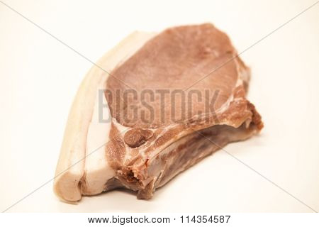 Pieces of fresh raw pork appetizing close-up on a white background