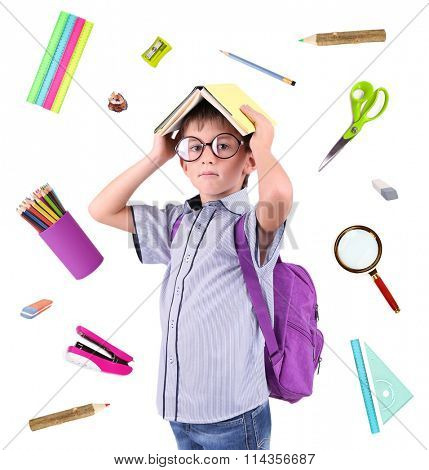 Cute schoolboy with supplies, isolated on white
