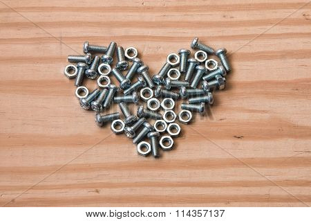 Closeup Of The Metal Screw In Heart Shape