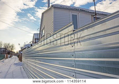 Suburban Fence Of Corrugated Galvanized Iron