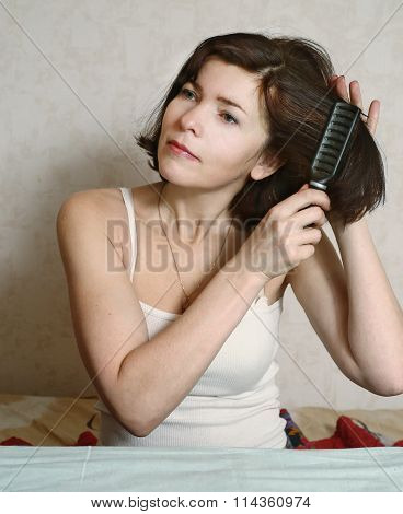 Woman  Try To Comb Hairs