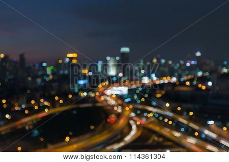 Blurred bokeh lights, aerial view city road interchanged
