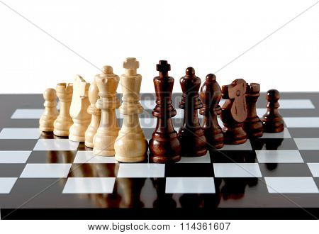 Chess pieces on board isolated on white