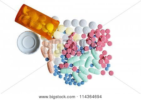 Orange bottle and colorful pills isolated on white