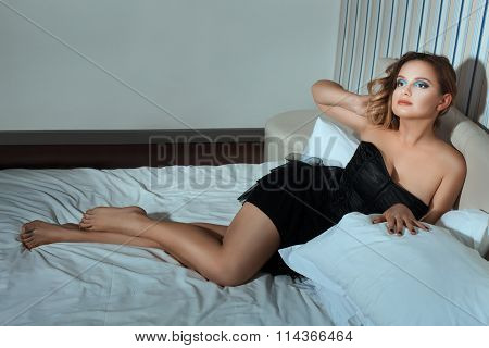 Beautiful Girl With Bare Feet On The Bed.