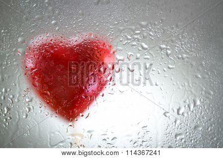 Red Heart Behind A Wet Window