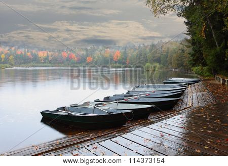 Row of rowing boats at Lower Tahquamenon Falls Pure Michigan