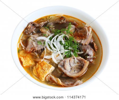 Bowl of Hue Beef Noodle soup isolated on white background