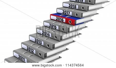 Folders stacked in the form of steps, marked the years 2011-2019. Focus for 2016