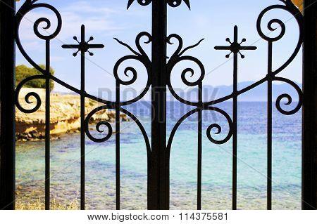 sea behind the railings
