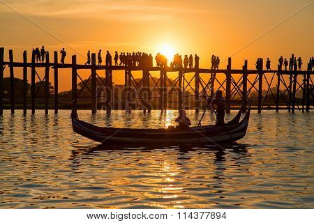 Silhouetted people on U Bein Bridge at sunset, Amarapura, Mandalay region, Myanmar