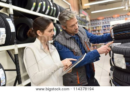 Mechanics with merchandiser checking products availibility