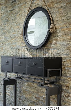 Vanity against brickwall old fashioned dressing table in home interior against brick wall