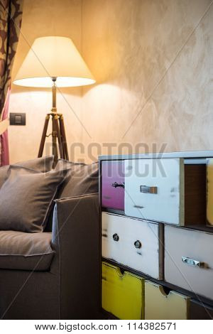 Vintage commode and armchair in apartment interior