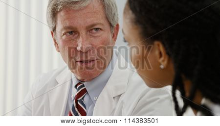 Two Doctors Sharing Their Professional Opinions About Patient's File