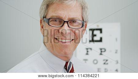 Senior Man Trying On New Glasses