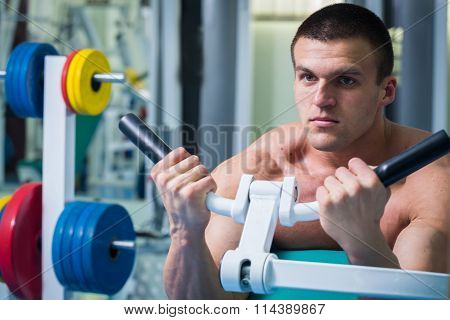 Strength training professional athlete in the gym.