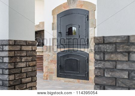 Firebox door of a retro wood burning stove