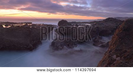 Long exposure of sunset over rocks