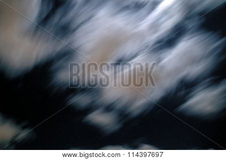 Clouds Under Moonlight With Stars