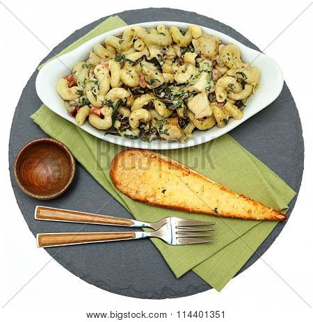 Baked Tuscan Chicken Pasta with Artichoke and Garlic Bread Over White